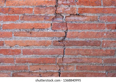 Old red brick wall texture background with scratches, cracks, dust, crevices, roughness.   Stonewall Background.Old brick wall.  Seamless bricks texture. Background brick. Wall texture