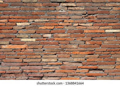 Old red brick wall texture background with scratches, cracks, dust, crevices, roughness.   Stonewall Background.Old brick wall.  Seamless bricks texture. Background brick.Wall texture