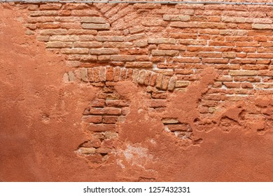 An old red brick wall in Venice, Italy.