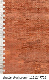 Old red brick wall with white stone side background vertical
