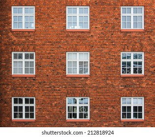 Old red brick wall with windows in Helsinki, Finland