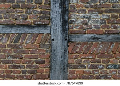 Old red brick wall with wood for support background