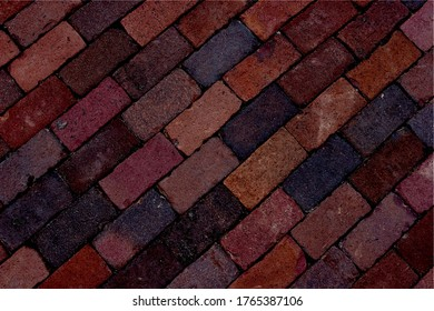 Old red bricked wall with leading lines. Perspective of leading lines in old red wall of a house.