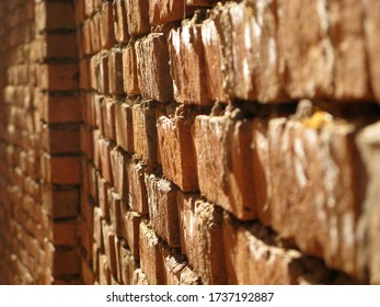 Old red bricks wall for a house in Africa.