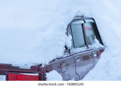Old red car in the snowdrift
