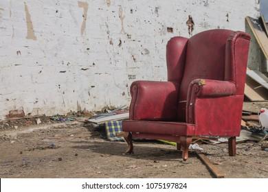the old red chair in the dump