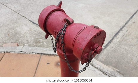 old red closeup firehydrant with chain