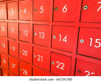 Old red deposit box with number Divided into channels.Vintage, key, the post office