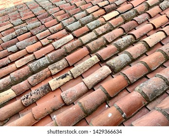 Old red earthenware roof tile texture