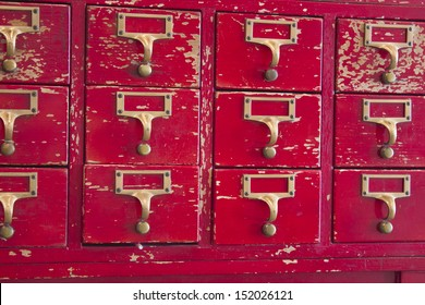 Old red and gold library card catalog.