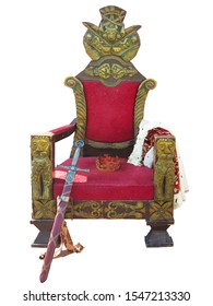 Old red golden king throne with sword and crown isolated over white background.