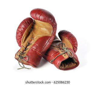 Old red leather boxing gloves isolated on white.