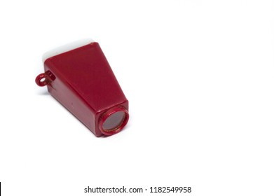 old red monocle with a small picture film inside, isolated on white background
