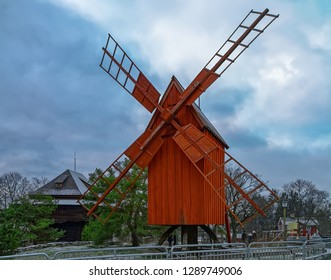 An old red ochre wooden windmill during winter in the Skansen open-air Museum of Architecture and Life located on the island Djurgarden in Stockholm, Sweden.