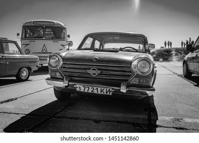 Old red rare car Morris Oxford on Old car land show april 2018 in Kiev Ukraine