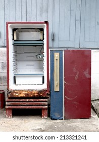 Old red refrigerator are dirty, defective, unavailable ready to out of stock.