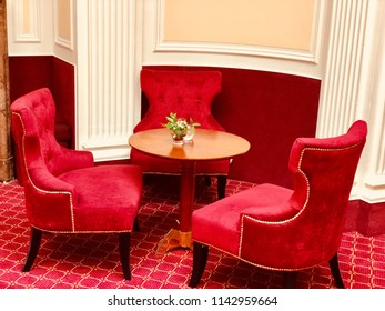 Old red retro chairs design on the red carpet