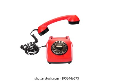 Old, red rotary dial telephone with hanging in the air receiver, isolated on white