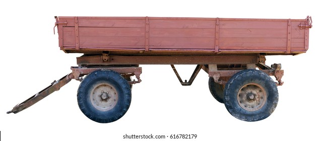 Old red rural tractor trailer cart isolated on white