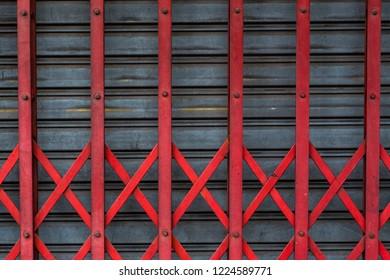 Old red rusty sliding metal door, Thailand