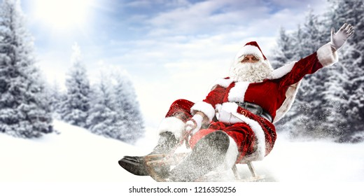 Old red santa claus and winter time. Landscape of trees and mountains. Free space for your decoration.