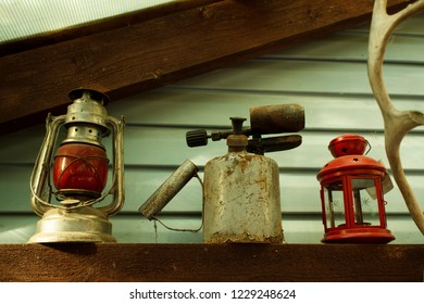 old red Soviet kerosene lamp, which was hung on the last carriage of a freight train, blowtorch, candlestick and a piece of antler - an interior in a country house. rarity. Russia.