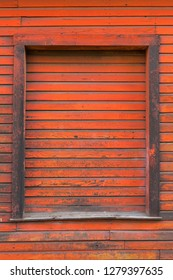 Old red storage warehouse barn door wood exterior siding grunge texture background