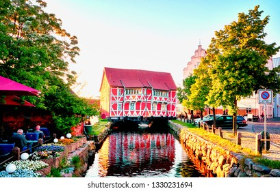 Old red timbered house and restaurant in Wismar on the canal. Baltic Sea in Mecklenburg-Vorpommern. germany