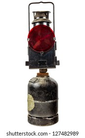 Old red traffic warning light running on gas isolated on a white background