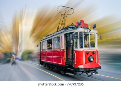 Old red tram at the street with motion blur.
