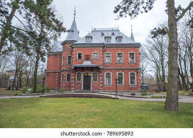 """Old red village at Riga, Latvia. Intresting building, old style. New it's museum """" Dauderi"""". Travel photo. 2018"""