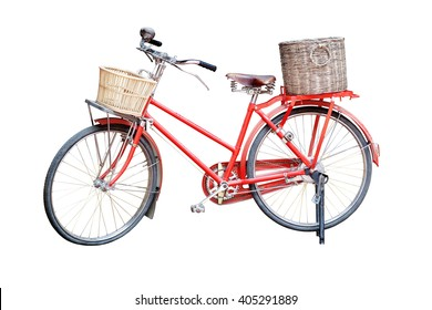Old red vintage bicycle with rattan baskets isolated on white background, clipping path included