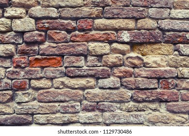 Old red vintage brick wall texture background.