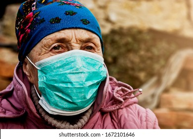 Old red wine in a medical mask close-up. Grandmother in a mask while spreading a coronavirus infection. Coronavirus panic. Quarantine and global emergency regarding deadly coronavirus