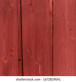 The old red wood texture with natural patterns.