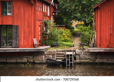 Old red wooden barns in the city of Porvoo in Finland.