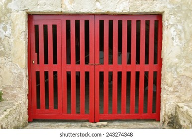 Old Red Wooden Door of a boat shelter in the Mediterranean Sea (Majorca)