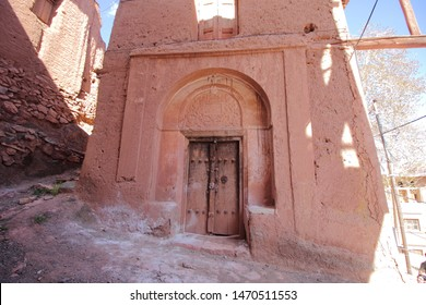 An old reddish hue clay or brick house in Abyaneh Village, the oldest Iranian traditional village in Isfahan Province, Iran..