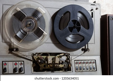 Old reel-to-reel recorder with magnetic tape on it