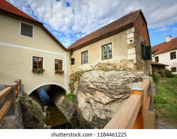 Old residential house on the rocky bank over a ditch. Town of Weissenkirchen in der Wachau, district of Krems-Land, Lower Austria, Europe.