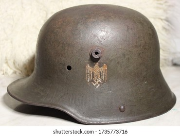 Old restored German helmet of the WW2 with the coat of arms of the Third Reich