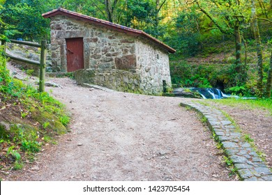 Old restored water mill on the stone and water route along Armenteira river in Meis town, Galicia Spain
