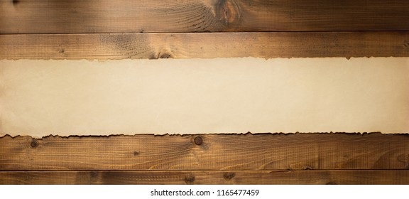 old retro aged paper parchment  at wooden background