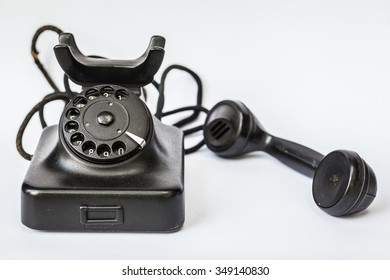 Old retro black phone, isolated in white background