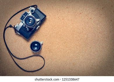 Old retro camera on cork wooden boards
