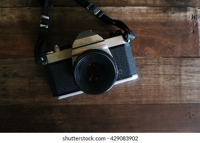Old retro camera on vintage wooden table