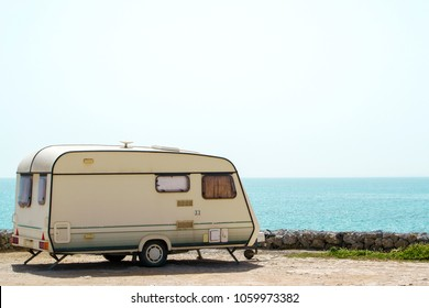 Old retro caravan staying on a beautiful sea coast