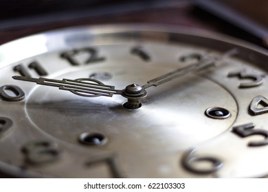 old or retro clock winding, close-up hands and face of the old mechanical watches.