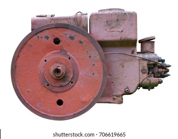 The old retro diesel engine for agricultural machinery was painted with red paint. Isolated on white