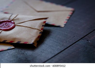 Old retro envelopes with a wax stamp on old wooden table